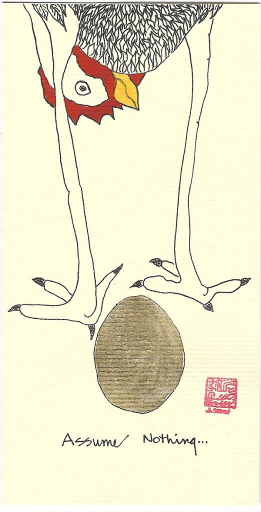 """A greeting card featuring a chicken laying a gold foil egg. It says """"Assume Nothing"""""""