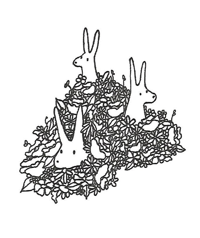 A card with rabbits in a pile of leaves