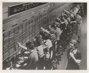 A Bell System switchboard where overseas calls are handled. Not all of the services shown are available during wartime conditions