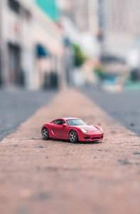 A tiny red Porsche